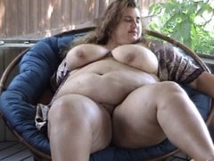 BBW chick masturbates on her patio with dildo.