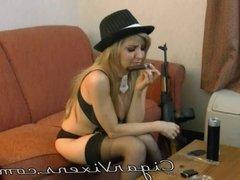 Angelina SMOKES a cigar