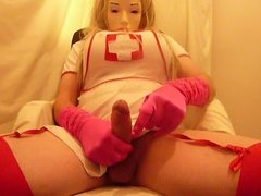 crossdresser plasticface cums on pink gloves