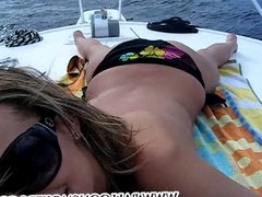 Hot teen Cheyenne smoking a cigarette on boat topless.