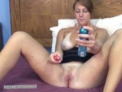 Busty redhead Mariah uses a toy