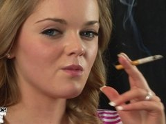 Cute Teen Smokes a Long Cigarette