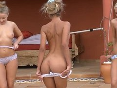 Three oiled lesbians have fun by the pool