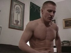 Muscled guy shows off and shoots his load