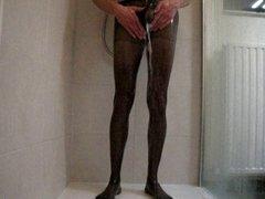 men showers in black pantyhose and red panties