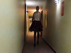 Sissy Ray in Hotel Corridor in Purple Maids Uniform