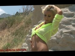 Blonde girl strips in front of the camera Part 1 of 2