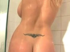 Sexy shower with a busty blonde