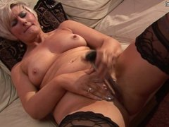 Hot cougar mom working out her pussy