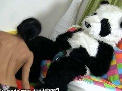 Young girl sucks a huge black dick toy panda