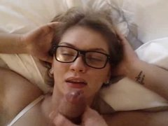 Chick with glasses gets a messy facial