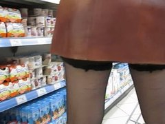 Girl in stockings without panties in a supermarket