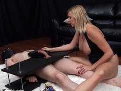 Mean dominant MILF uses helpless slave during handjob
