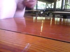 Cumming on a picnic table at work