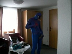 blue spiderman shows cock