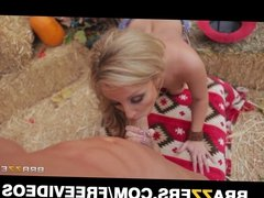 Busty blonde cowgirl goes for a roll in the hay