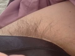 pubic hair sticking out of her black pantys.
