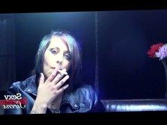 Elegant Brunette Smoking with a Cigarette Holder