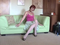 Red housewife mom playing on her bed