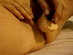 Chubby granny masturbating on bed part 2