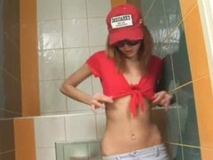 Amazingly skinny cute chick on toilet