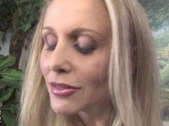Posh cougar Julia Ann gets many black cocks in front of