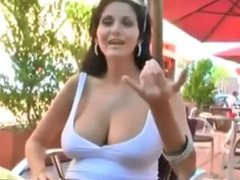 Very beauty brunette shows her huge boobs in a street cafe