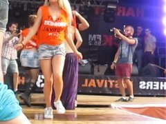 Girl in fishnet stockings dancing on a stage