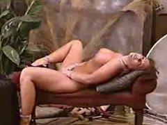 Busty MILF with genetal and nipple piercings posing on camer