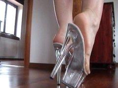 Slutty blond's shoejob with her transparent platform heels