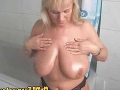 Super busty blonde MILF massaging her huge tits in shower