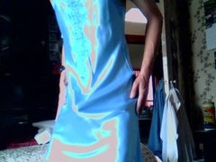 Contact of penis with soft blue satin chemise.