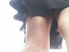 Upskirt of tall redhead