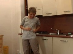 Over 60 granny gets herself off in the kitchen