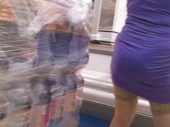 Girl in blue dress and tan stockings in supermarket 1