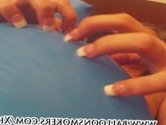 Hot teen topless popping balloons with her nails