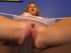 Girl in white stockings takes huge black cock