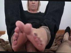 Blonde mistress gives a Footjob 2013