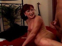 Redheaded granny with small tits rides cock