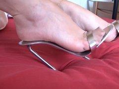 Sexy feet in metal heels