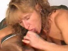 Mature gives a blowjob with cumshot in mouth