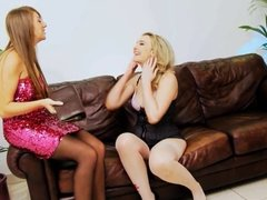 British lesbians playing on the sofa in stockings