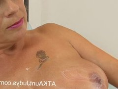 MILF Dimonte strips naked