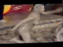 CLOTHED Mudwrestling British Chicks wrestle in mud