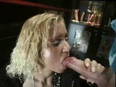 Blond Bitch blows cock in the sex shop