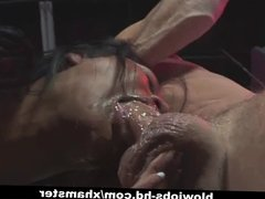 Caged Asian babe gives blowjob and takes mouthful
