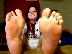 Shy girl wants you to smell her feet.
