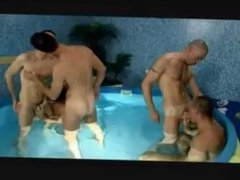 Steamy gay orgy in the pool.
