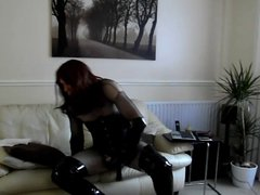 Wanking in fishnet body stocking, thigh boots and butt plug