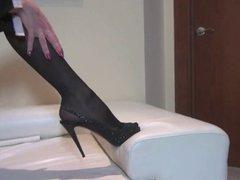 Ana Mancinis black heels and stockings